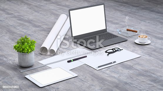 istock Laptop on a desk with accessories, blank screen mock-up isometric 955345960