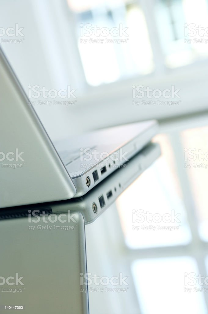 Laptop on a glass table royalty-free stock photo