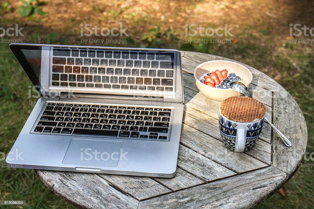 Laptop on a table stock photo