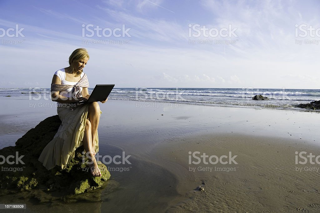 Laptop on beach royalty-free stock photo