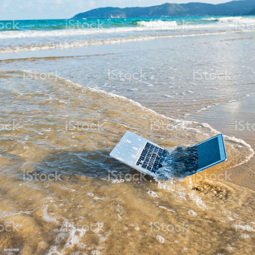 laptop on beach stock photo
