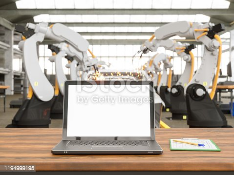 1069360792 istock photo Laptop on desk in a Factory 1194999195