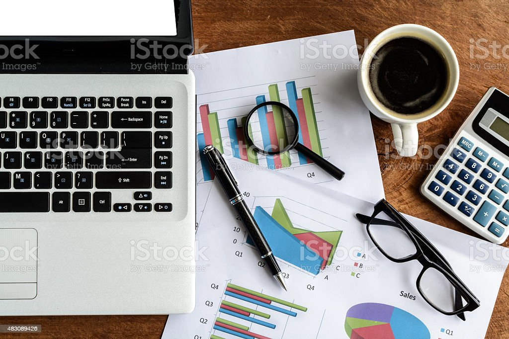 Laptop on Desk office and Graph analysis spreadsheet, Business f stock photo