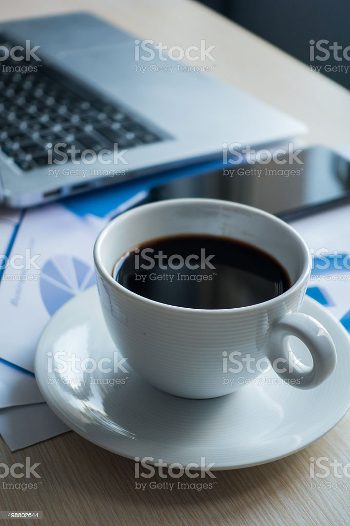 Laptop on Desk,office and Graph analysis spreadsheet stock photo