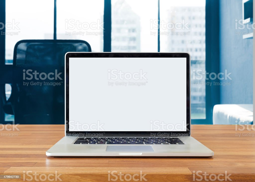 Laptop on table, on office background stock photo
