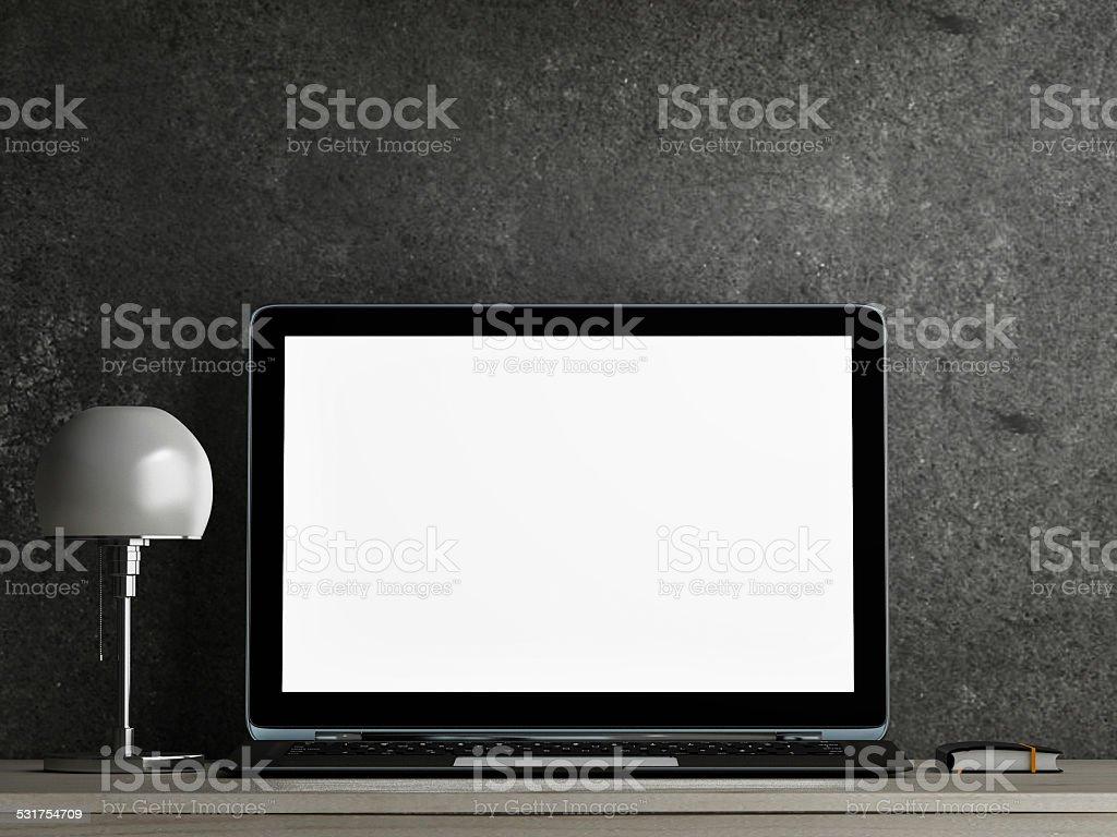 Laptop on table stock photo