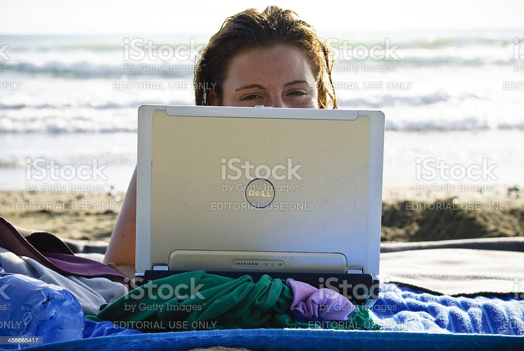 Laptop on the beach stock photo