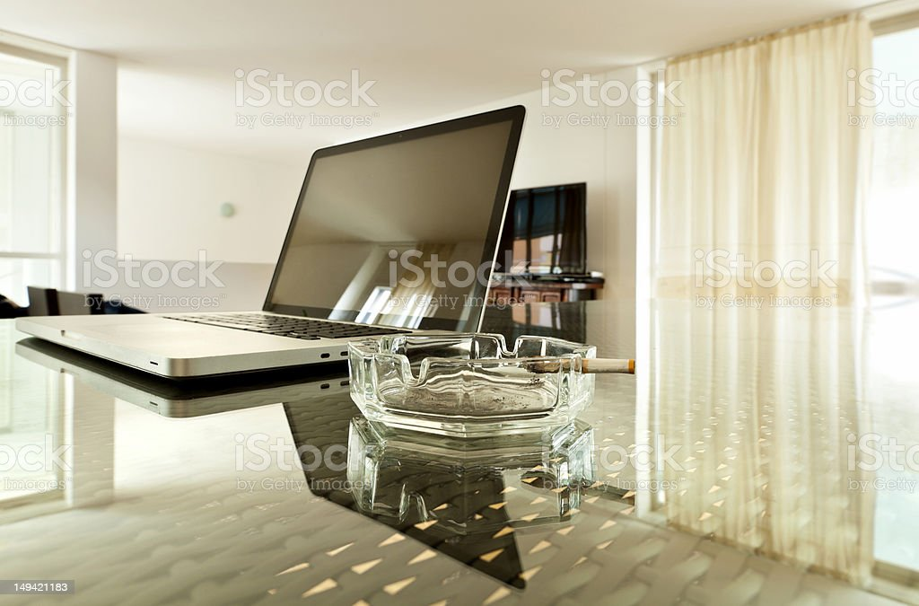 laptop on the glass table royalty-free stock photo