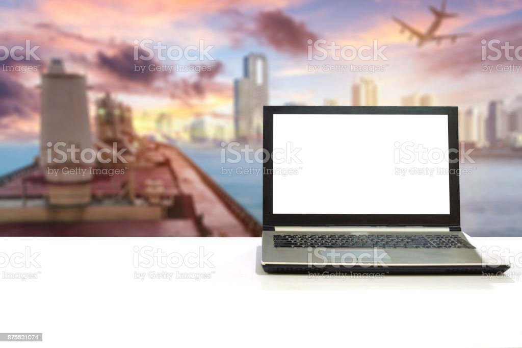 Laptop on white desk with blurred scene cargo shipping with plane export to city stock photo
