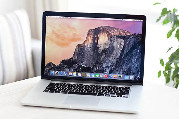 Laptop on white table stock photo