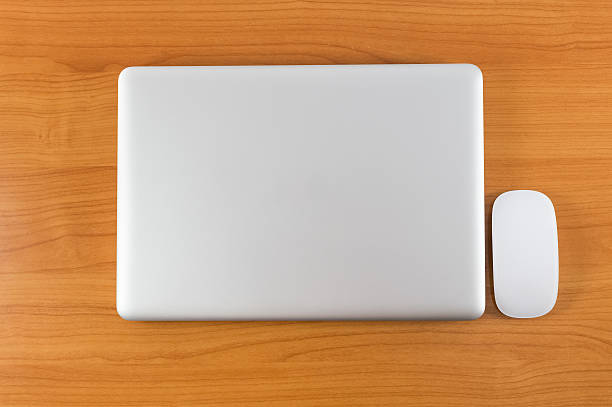 laptop on wood table - closed stock photos and pictures