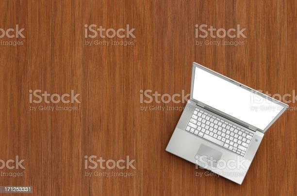 Laptop On Wooden Floor Stock Photo - Download Image Now
