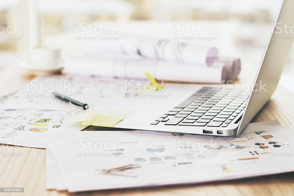 laptop on wooden surface side stock photo