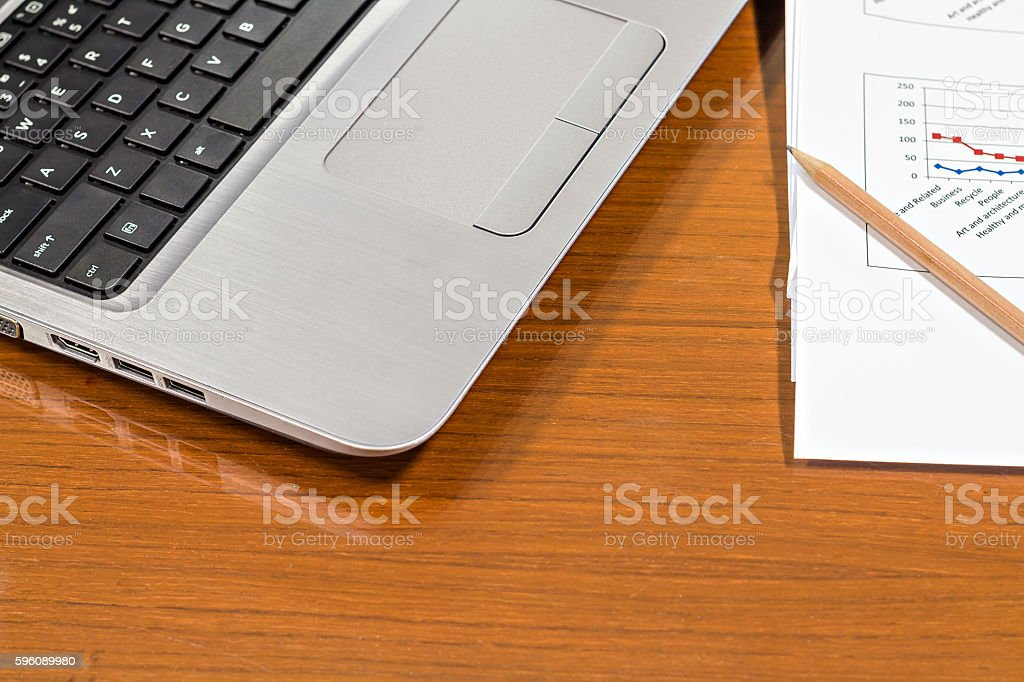 Laptop, pencil and report paper on vintage office wooden desk royalty-free stock photo