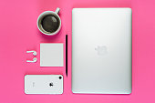 istock Laptop Phone Coffee Cup on Pink Background Flatlay 1183956921