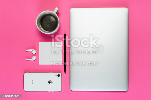 1202959798istockphoto Laptop Phone Coffee Cup on Pink Background Flatlay 1183956921