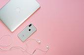 istock Laptop Phone Earphone Pink on Minimal Top Layout 1183957025