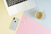 istock Laptop Phone Workplace Pastel Background Flat Lay 1183957147