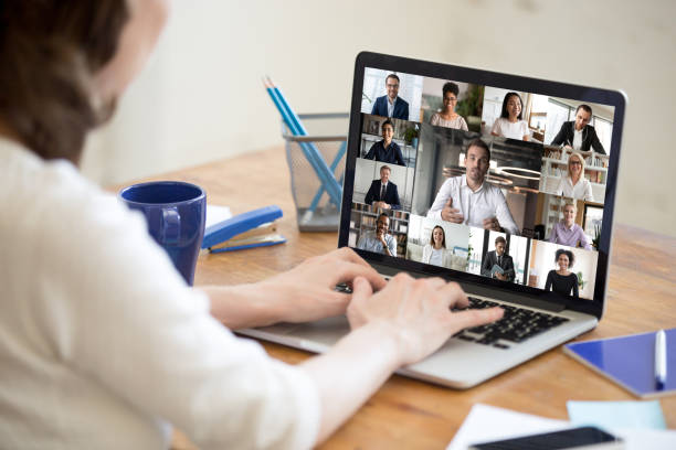 Laptop screen view diverse businesspeople involved at group videocall stock photo