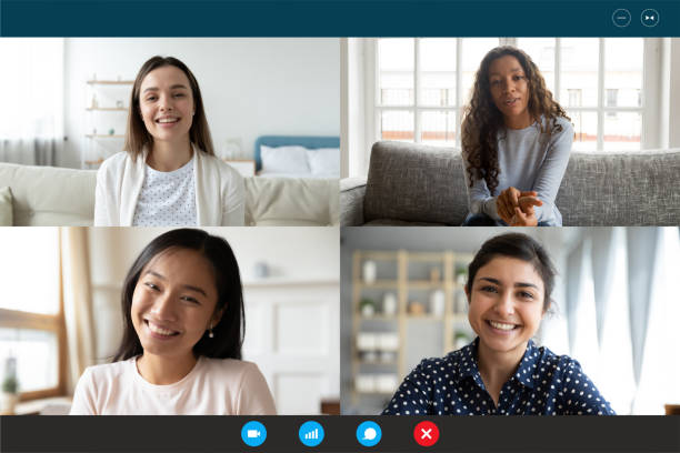 Laptop screen webcam view multiethnic women involved in group videocall stock photo