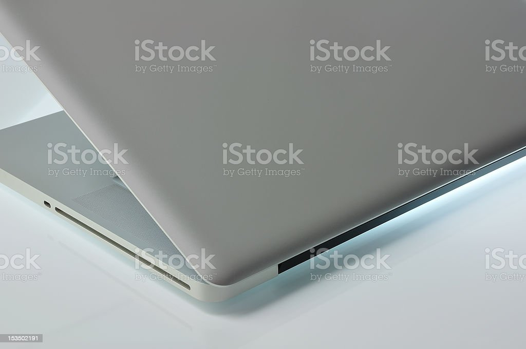 Laptop semi-closed (side view) stock photo