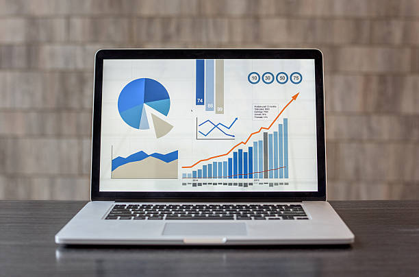laptop showing business graphs at the office - digital viewfinder stock photos and pictures