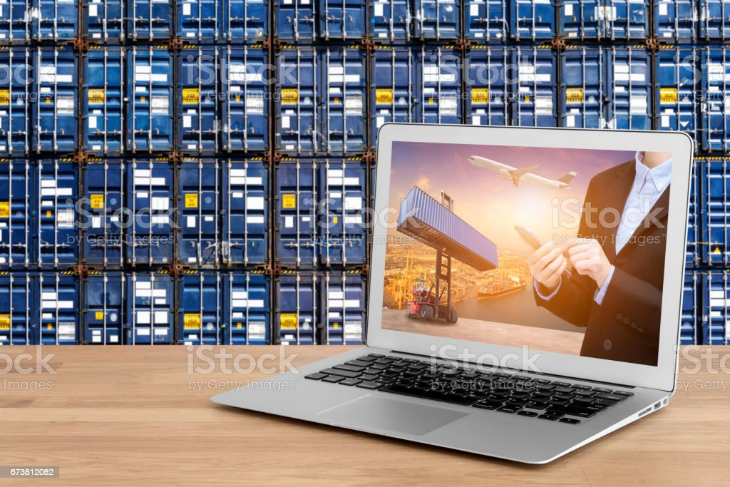 Laptop showing business shipping and internet of things technology stock photo