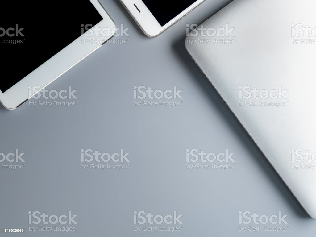 Laptop, smartphone and tablet on gray background