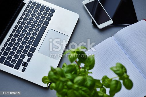 Open laptop, tablet, smartphone and notebook on a table in the office