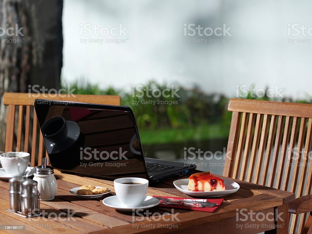 Laptop to a cafe royalty-free stock photo