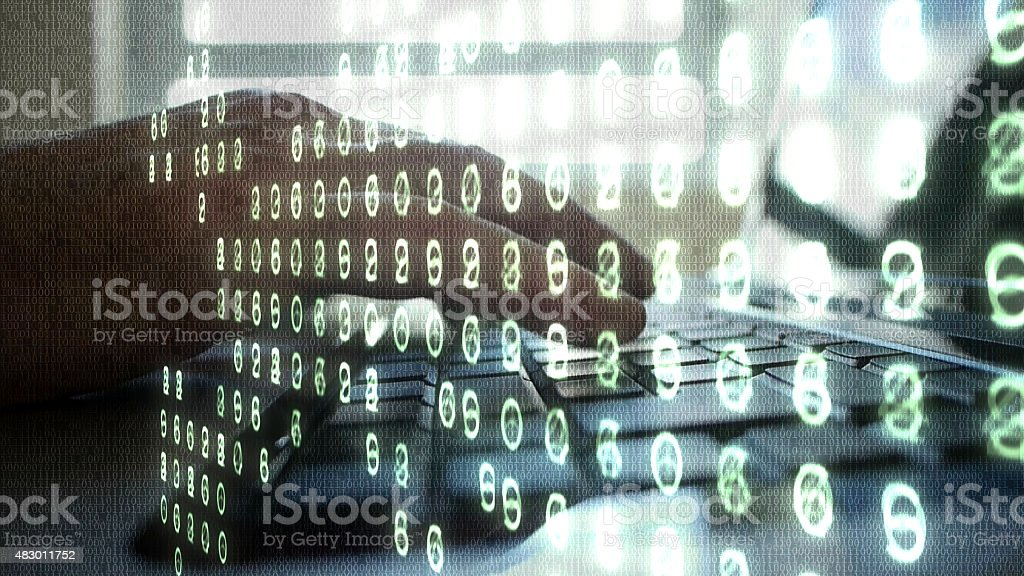 Laptop typing close up overlaid with binary code and numbers. stock photo