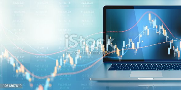 Laptop standing in front of defocused background. A chart graph is displayed on the laptop's screen. Horizontal composition with selective focus and copy space. Finance and investment concept. Front view.