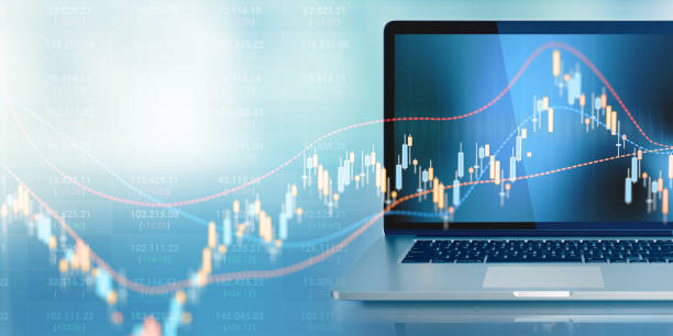Laptop With A Chart Graph Displayed On Its Screen Sitting In Front Of Defocused Background - Finance And Investment Concept Laptop standing in front of defocused background. A chart graph is displayed on the laptop's screen. Horizontal composition with selective focus and copy space. Finance and investment concept. Front view. financial report stock pictures, royalty-free photos & images