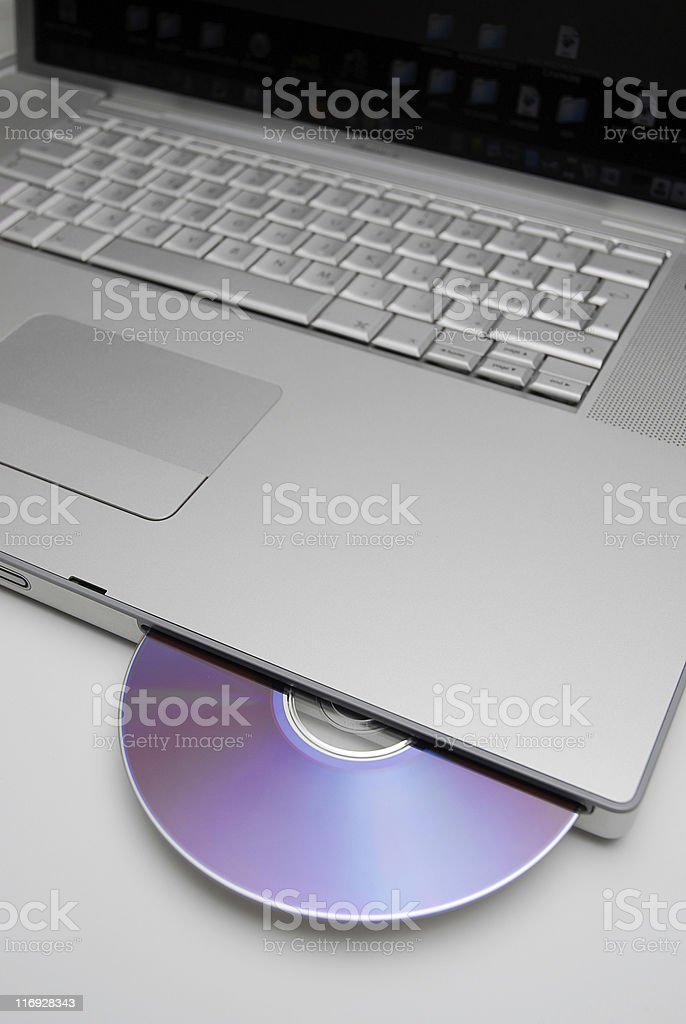 Laptop with a disk dvd stock photo