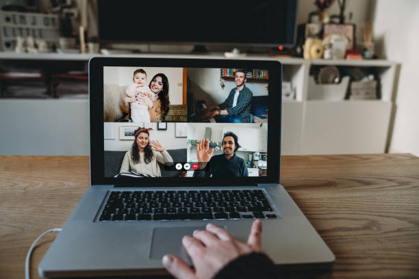Laptop with a videoconference call on the screen stock photo