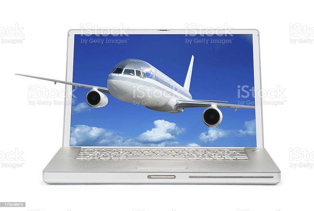Laptop with Airplane Flying Out from the Screen royalty-free stock photo