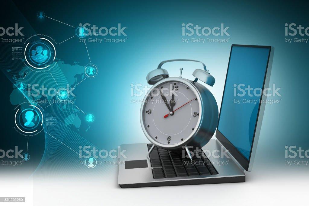 Laptop with alarm clock royalty-free stock photo