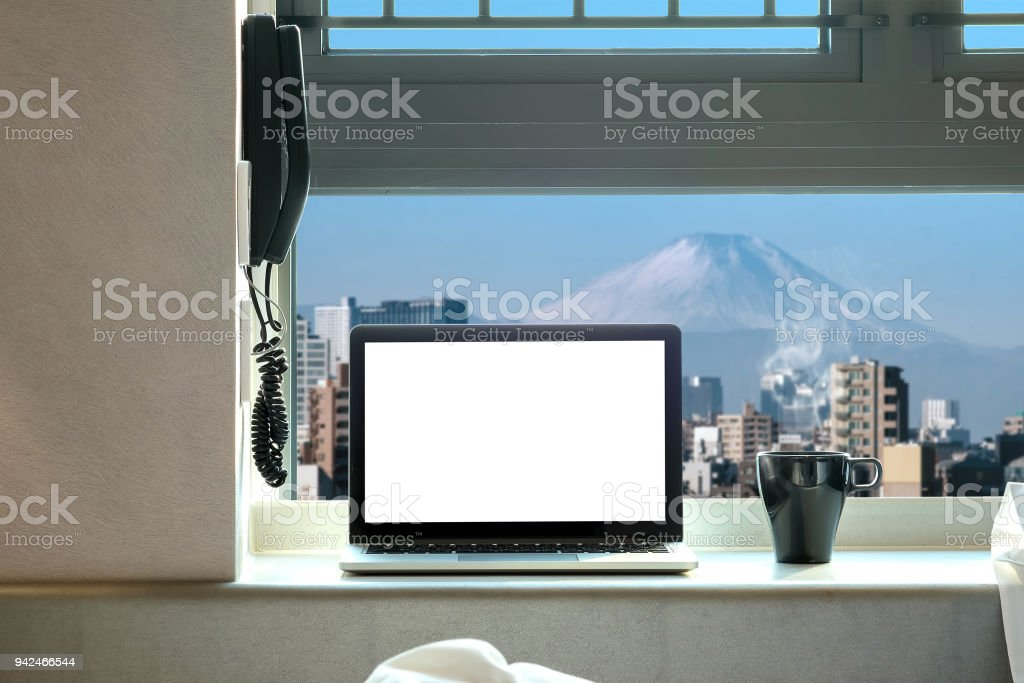 Laptop with blank screen in high floor in bedroom with morning coffee with tokyo mt.fuji background stock photo