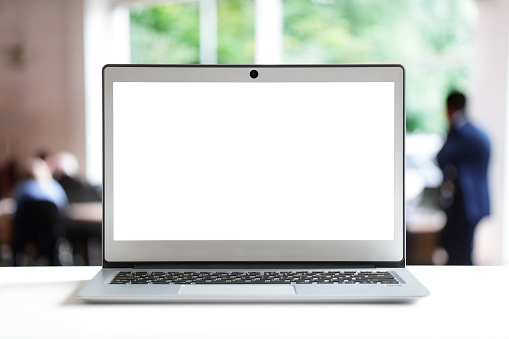 Laptop with blank screen copy space in office ready for content or mock up