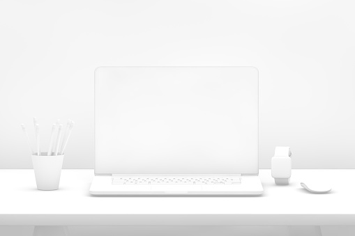 istock Laptop with blank screen on desk with white background 1080760742