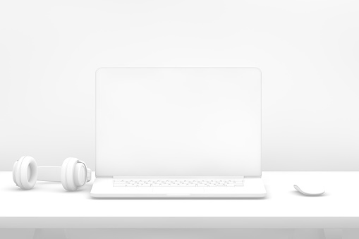 istock Laptop with blank screen on desk with white background 1080761142