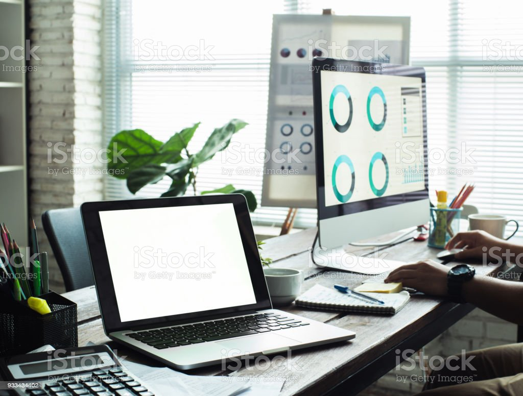 laptop with blank screen on table in office hipster