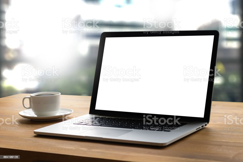 Laptop with blank screen on table interior, man at his workplace using technology stock photo
