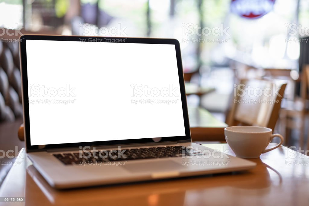 Laptop with blank screen on table. Workspace background new project on laptop computer with blank copy space screen for your advertising text message royalty-free stock photo