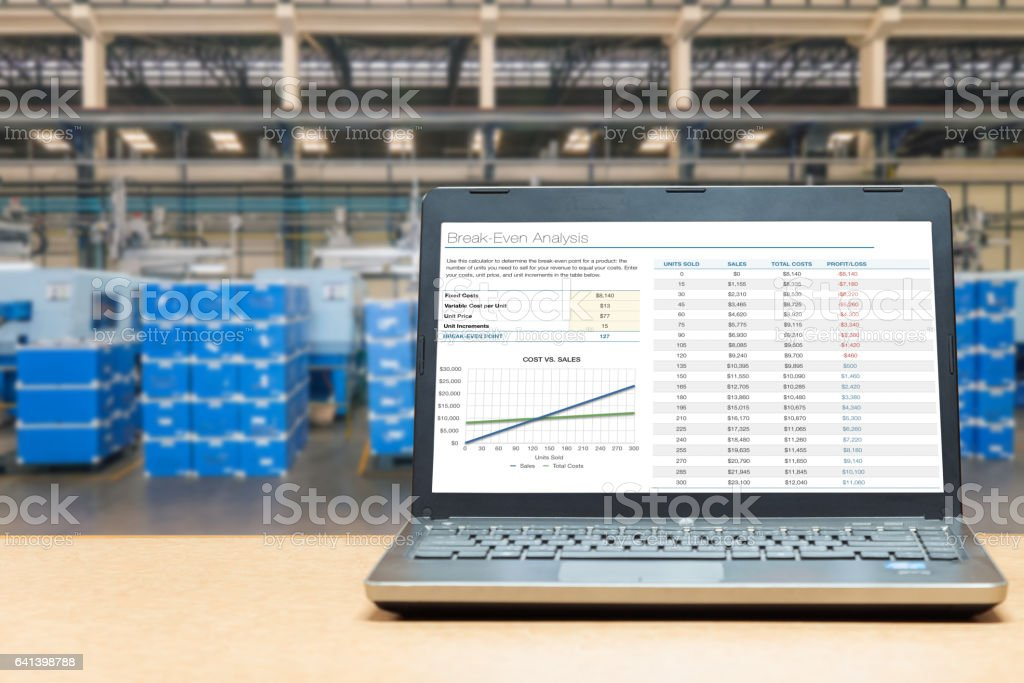 Laptop with blank screen with warehouse cargo in factory. stock photo