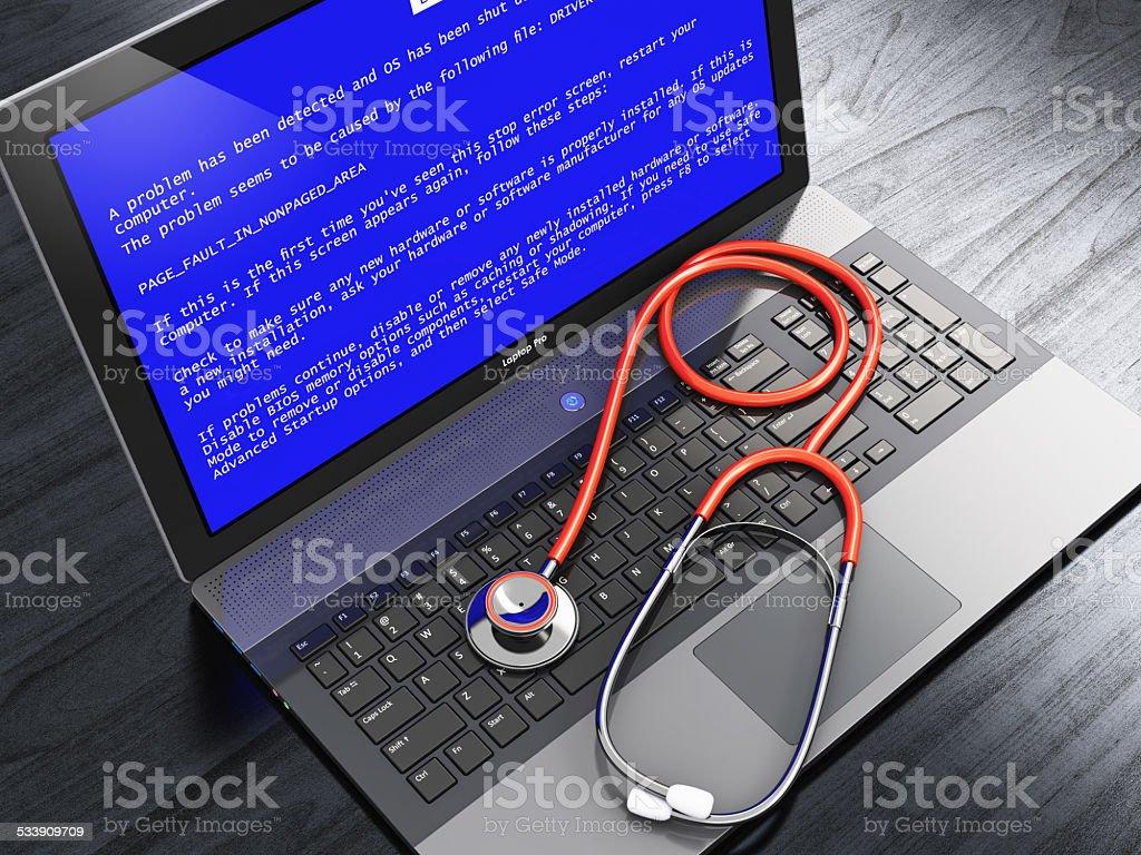 Ordinateur portable avec écran bleu d'erreur et stéthoscope - Photo