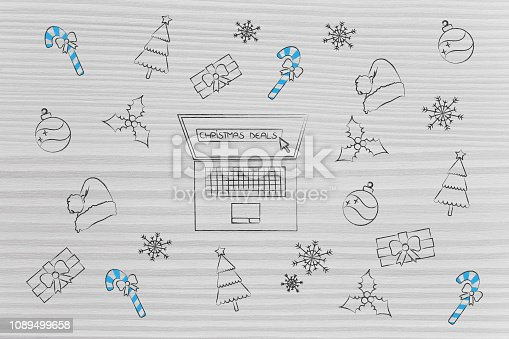 Christmas sales concept: laptop with shop promotions and decoration icons surrounding it