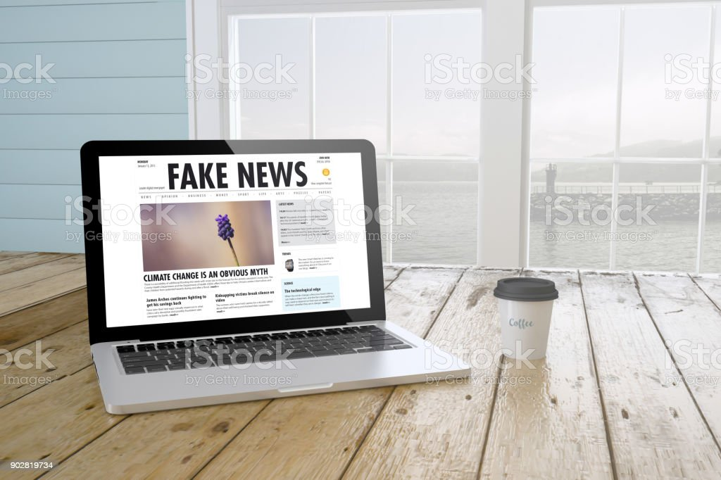 laptop with fake news on screen with port background and coffee stock photo