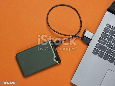 Laptop with flash drive, external hard drive
