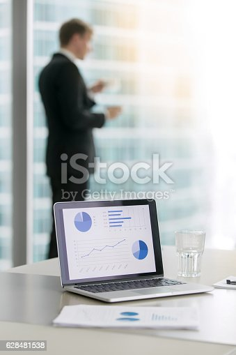 istock Laptop with growing business diagrams 628481538